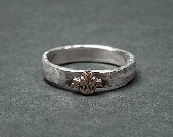 Silver (ring type baroque with a fleur de lis brass)
