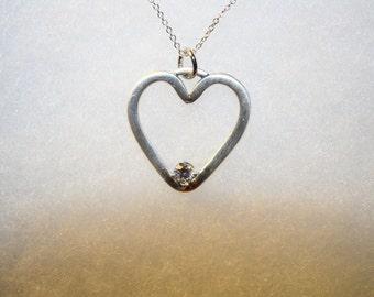 Fine silver heart with AAAAA cubic zirconia center stone.