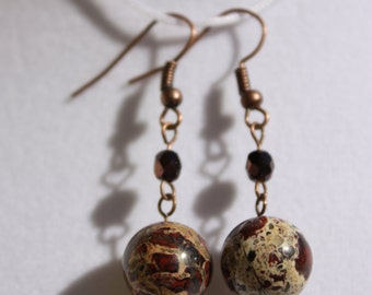 Antiqued copper sets off these brecciated jasper stone earrings. At 1 1/2 inches natural jasper hangs from antiqued copper french ear wires.