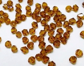 100pcs GOLDEN Brown colored 4mm Bicone glass crystal beads for jewelry making. Make your own Beautiful Accessories. Craft Supplies.