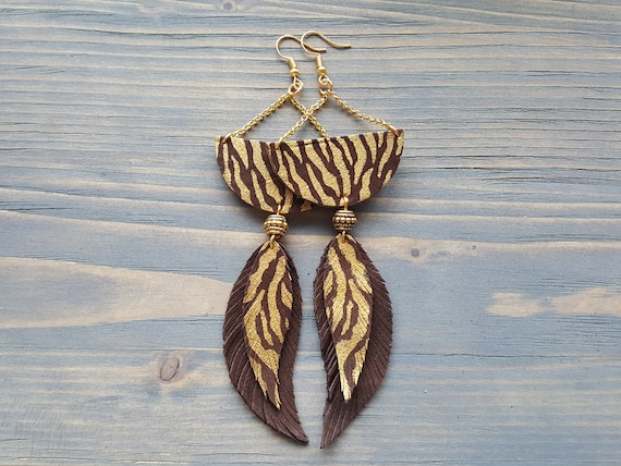 African earrings. Tribal earrings. Large leather earrings. Exotic animal print Gold African jewelry. Boho earrings Bohemian feather earrings