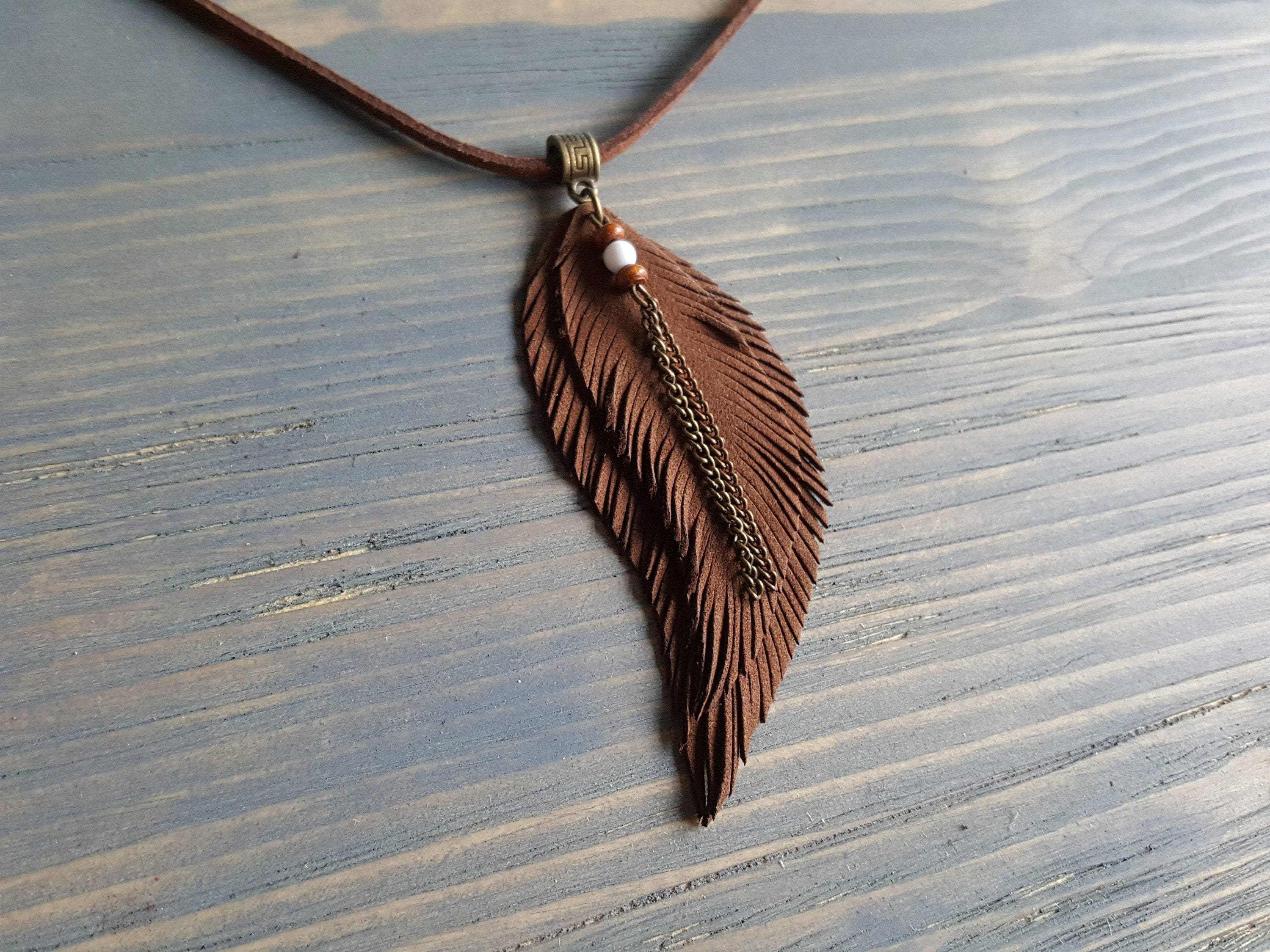 3a1ac7ad6e2af ... feather necklace Hippie necklace Leather choker Boho chic. gallery  photo gallery photo gallery photo gallery photo gallery photo ...
