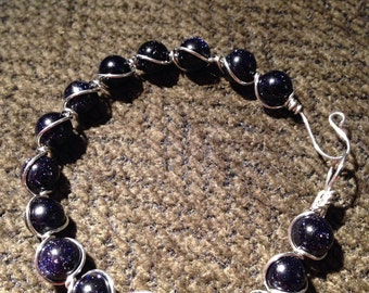 Blue goldstone wire wrapped bracelet. Made to order.