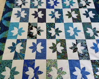 Unfinished quilt top in metallic blues