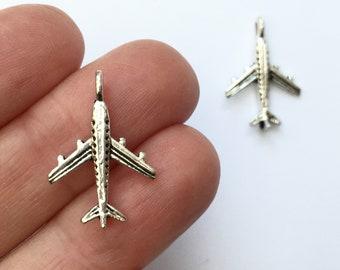8 Aeroplane charms antique silver tone TT18