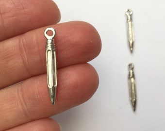 4 Red pencil charms resin PT40