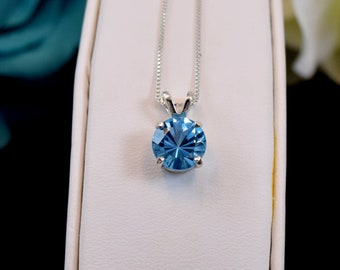 d1040125c 8mm, Round, Concave Cut Natural Swiss Blue Topaz necklace from Brazil.  Premium Sterling Silver, Pendant or chain.