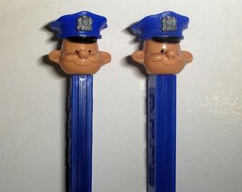 Vintage Policeman A Pez dispenser with snap-on cap, blue stem. Near mint, vintage Pez, Austria 2 6 stem, 1970s Pez, Policeman Pez