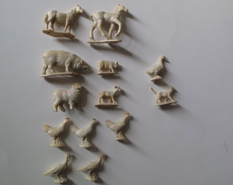 Vintage miniature animals, set of 13 rubber farmyard animals from 60s or 50s, unpainted, no mfr.