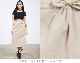 f4c68e7874c vintage 90s skirt vintage 1990s tan business casual skirt with bow  detailing vintage boss lady skirt with slit at side