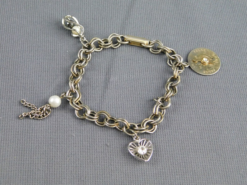 Lie Detecter Heart Unsigned Vintage Charm Bracelet with 4 Charms Silver /& Gold Tone Faux Pearls Clear Rhinestone 6-12 Long Tassel