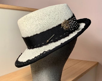 Black and white Fedora with Pin and guinea feathers!