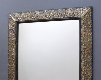 Mirror: wall mirror, gilted with oxidized copper leaves
