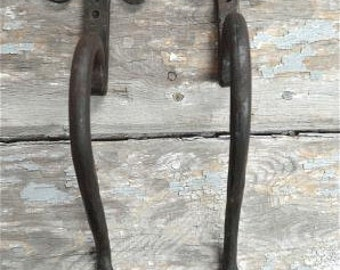 A pair of hand wrought iron early English Gothic door pulls BL12