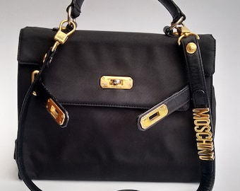 e19bf2c4aab46 MOSCHINO Bag. Moschino by Redwall Vintage Black Shoulder bag with  detachable lettered strap . Italian designer purse