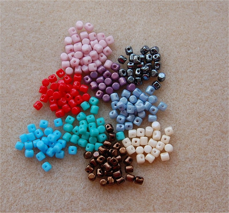 approx 10 gms of each MINOS Beads 9 colours listed below. \u00aePar Puca\u00ae a total of approx 90gms BARGAIN BASEMENT