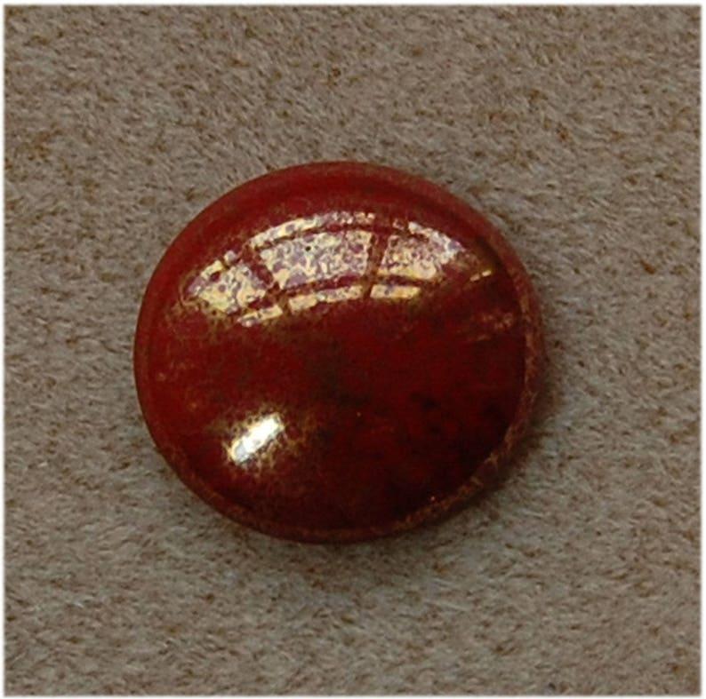 9312015496 CABOCHON  Beads \u00aePar Puca\u00ae Opaque Coral Red Bronze 25mm sold in units of 1 Cabochon.