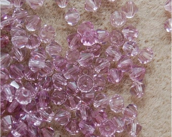 CZECH PRECIOSA Bicone Crystals, 4mm, Transparent Light Amethyst, sold in a unit of 120 crystals.