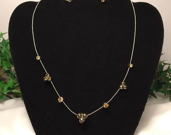 Vintage Gold tone wire necklace featuring Amber Rhinestones