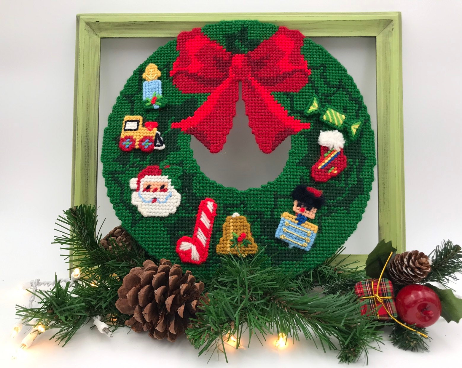Country Christmas Background.Vintage Christmas Wreath Yarn Cross Stitch On Plastic Red Bow