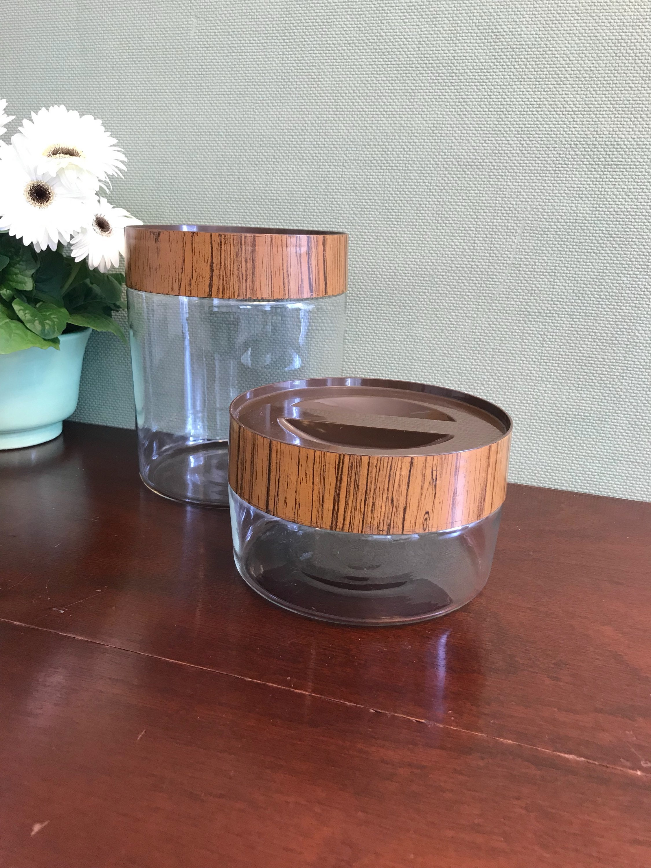 vintage pyrex canisters with faux wood lids, see n store glass canisters, mid century modern
