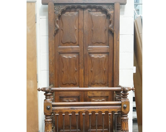 Fabulous Gujarat teak double door with ornate carved arch frame and balcony