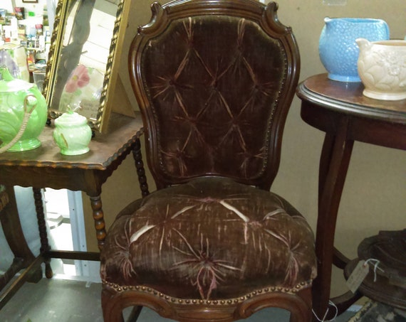 Antique Victorian chair with button upholstery and mahogany frame possibly French
