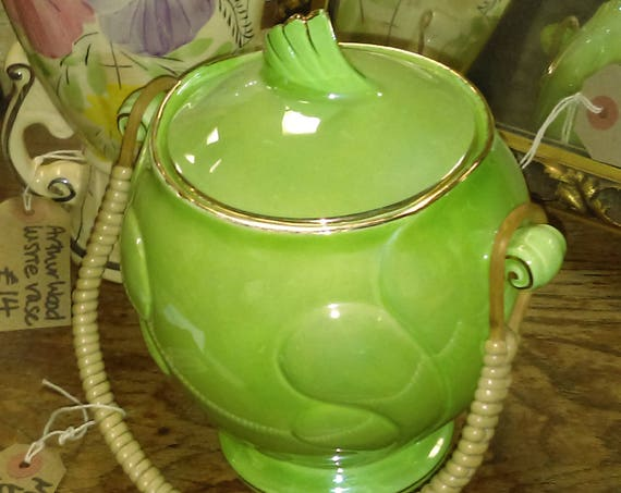 Pretty and decorative Art Deco Malings green lustre biscuit barrel