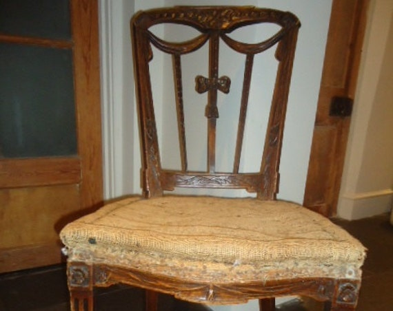 Antique carved French Louis style salon chair for upholstery with ribbon back