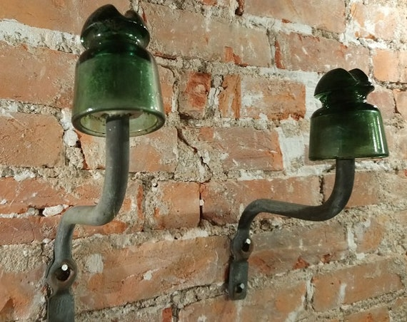 Vintage French glass and metal electrical insulators repurposed as coat hooks