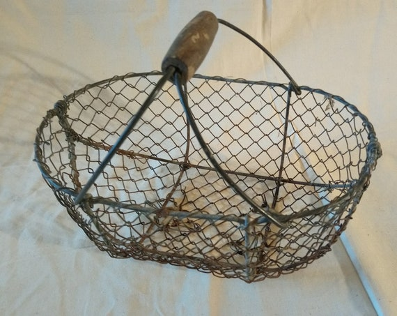 Old antique French petite rustic wirework basket with wooden handle
