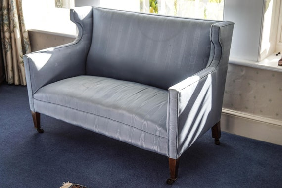 Beautiful antique elegant wing back Nineteenth Century sofa for upholstery project