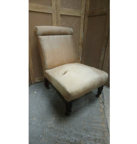 Antique Victorian roll top nursing chair for upholstery project