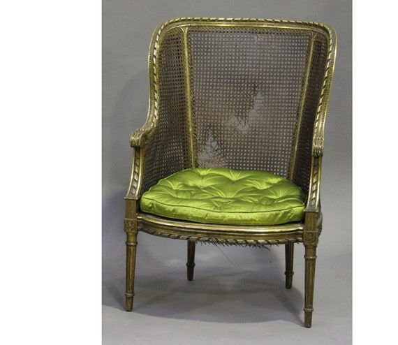 Antique cane wing back carved gilt framed Louis XVI style chair with squab cushion