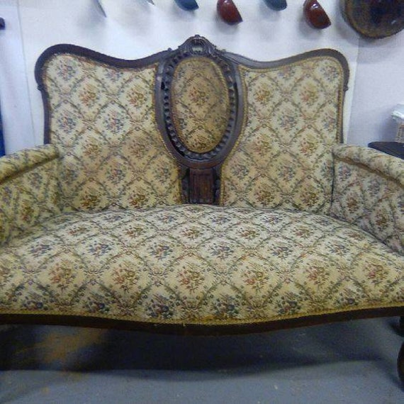 Beautiful antique French sofa with ribbon back carving