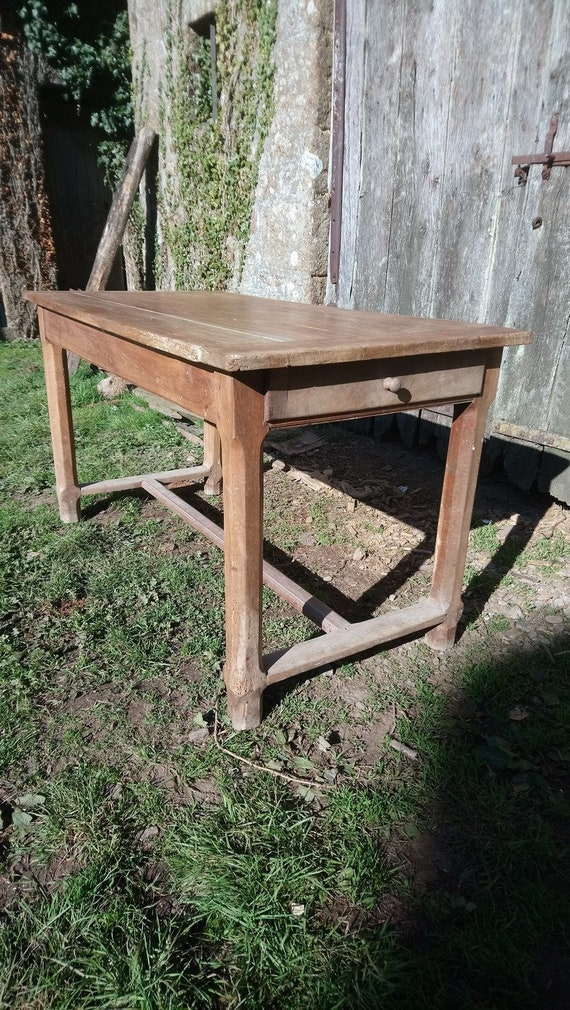 Antique French cherry wood planked top farmhouse dining table with drawers