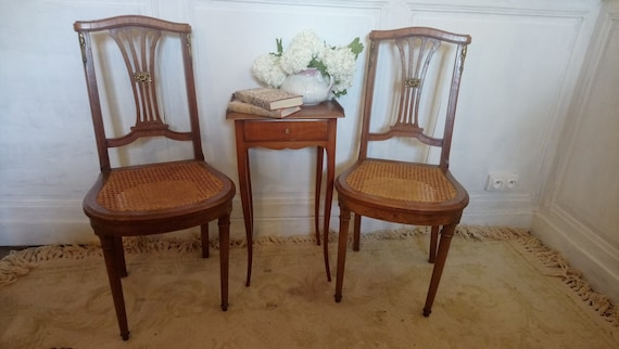 pair of chairs French antique cane seated Empire style bronze d'or decorated chairs