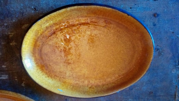 Fabulous 1960's Rene Milon French art pottery oval platter in amber colour