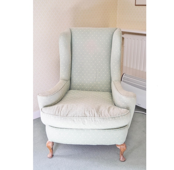 Antique Queen Anne style wing armchair suitable for a reupholstery project
