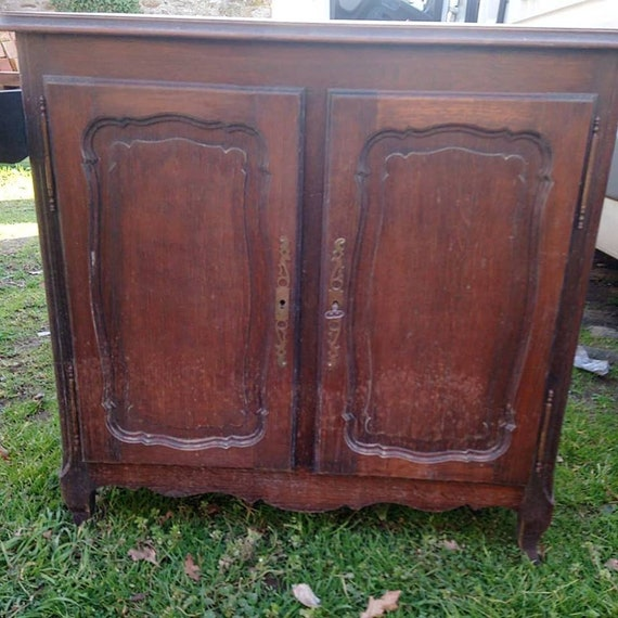 Antique French oak sideboard cupboard with carved door panels