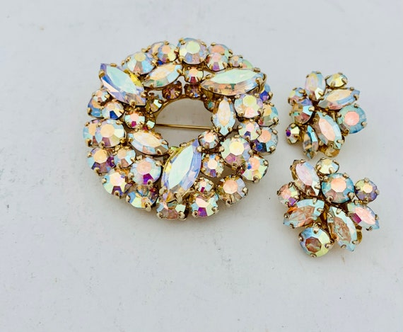 Signed Sherman Aurora Borealis crystal brooch and