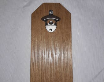 Wall mounted bottle opener with magnetic cap catcher