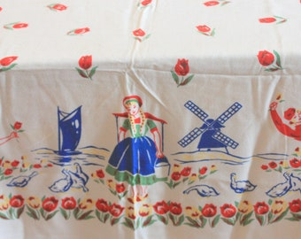 yellow and orange rectangle tablecloth tulips and adorable dutch boy and girl.In green vintage tablecloth all about Holland with windmills
