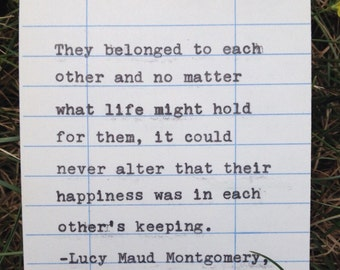 """Lucy Maud Montgomery quote from """"Anne of Green Gables"""" hand typed on library due date card"""