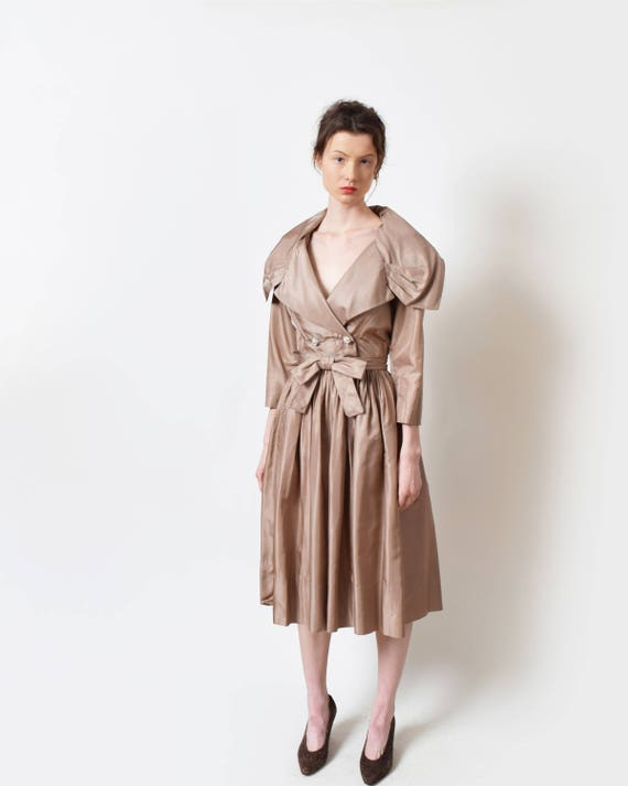 9c71ffe79a 1950s-richard-cole-taupe-silk-dress-with-dramatic-
