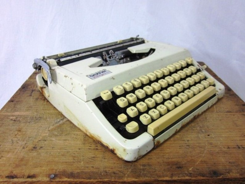 Image result for 1950's brother typewriter in case