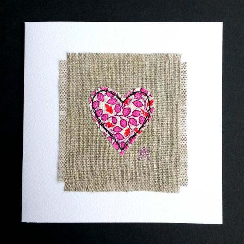In pure natural linen and white textured card. Linen anniversary greetings card for her Embroidered with pink floral heart design
