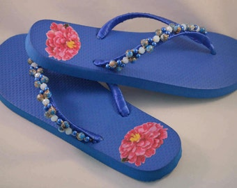 5a51ab1b7ae4 Blue beaded flip flops