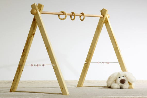 à vendre attrayant et durable marques reconnues Montessori Baby gym, portique d'éveil, 3 anneaux, sphères en bois sur les  côtés.