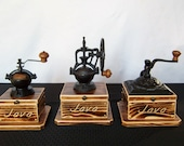 Coffee Grinders, choose from 3 Antique styled burnt -Pine wood with Java engraving, cast iron body with a ceramic mechanism and hinge top.